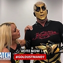 Mandy_Rose_shows_Goldust_how_to_improve_his_glutes_during_WWE_MMC_Second_Chance_Vote_mp40121.jpg