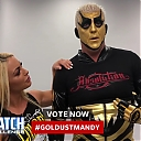 Mandy_Rose_shows_Goldust_how_to_improve_his_glutes_during_WWE_MMC_Second_Chance_Vote_mp40124.jpg